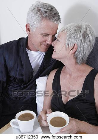 from Izaiah characture older couple having coffee