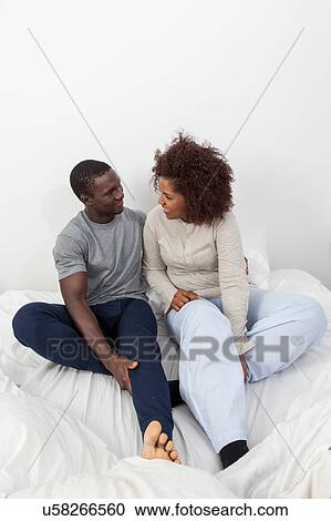 Stock photography of black couple in love in the bed for Love pictures in bed