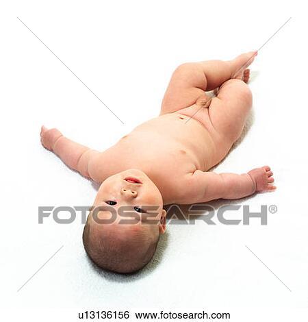 Naked baby lying on money