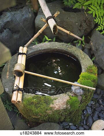 Stock Photo of Stone water basin in Japanese garden, Japan, high angle ...