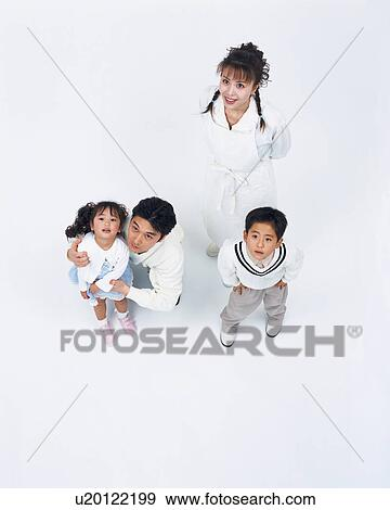 Stock photograph of a family looking in one direction u20122199 stock photograph a family looking in one direction fotosearch search stock photography voltagebd Choice Image