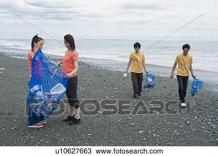 People Cleaning The Beach Young People Cleaning Beach