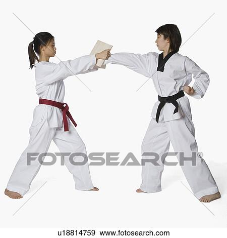 Stock Photograph of Female karate instructor teaching martial arts ...