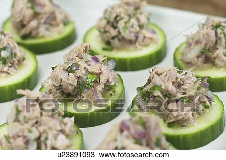 Stock photo of tuna and cucumber canapes with recipe for Canape calculator