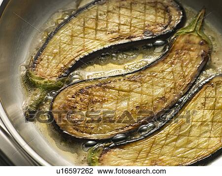 Stock Photo of Eggplant Frying in Corn Oil u16597262 - Search ...
