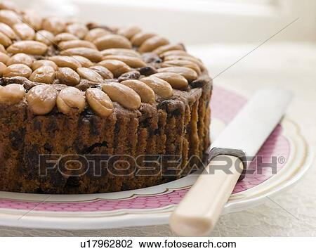 Dundee Cake Clip Art : Stock Photo of Dundee Cake on a Plate u17962802 - Search ...