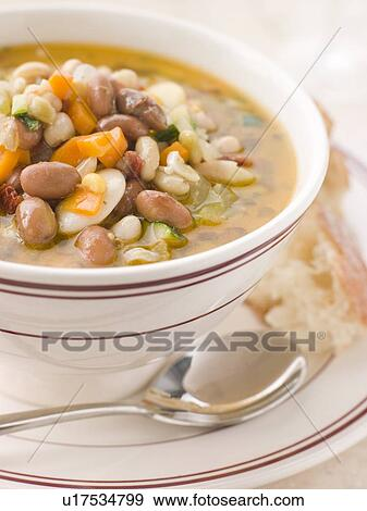 Stock Photograph - Tuscan Bean Soup with Crusty Bread. Fotosearch ...