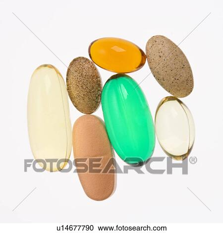 Stock Photography - Close up of supplement vitamin pills against white