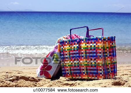 banque de photo sac plage serviette sur plage. Black Bedroom Furniture Sets. Home Design Ideas
