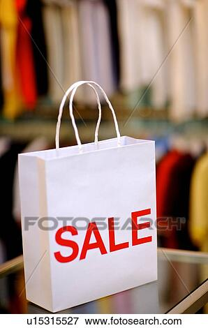 White shopping bag with the word sale across it fotosearch search