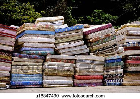 Matratzenstapel  Stock Photography of Old cushions and mattresses in stacks, in a ...