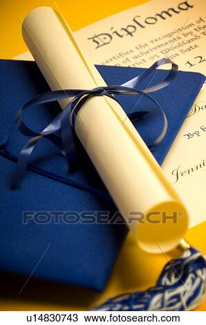 stock photo of graduation cap diploma and tassel u  stock photo graduation cap diploma and tassel search stock images poster