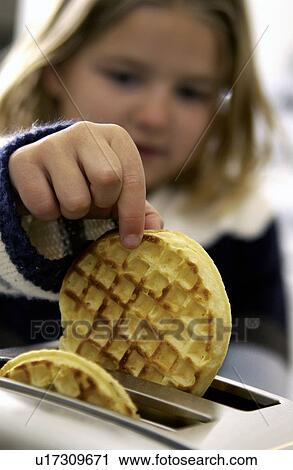 Stock Photography Of Little Girl Taking Waffle Out Of