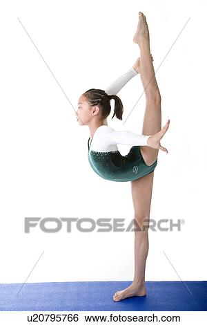 Stock Images Of Girl Practicing Gymnastic Pose On Pad
