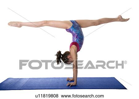 Pictures Of Girl Practicing Gymnastic Pose On Pad