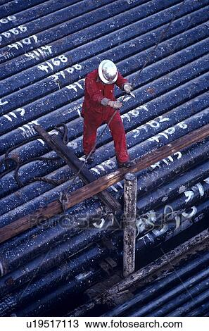 Gas Usage Calculator >> Stock Photo of Offshore Oil Drilling Rig Worker Lifting Drill Pipe u19517113 - Search Stock ...