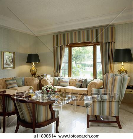 Neutral Striped Armchairs And Curtains In Traditional Living Room