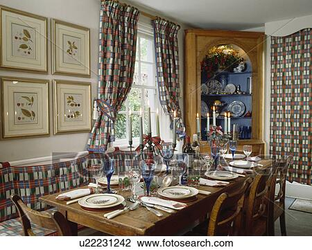 Red, White And Blue Checked Curtains And Cushions In Dining Room With Place  Settings On Rectangular Wooden Table
