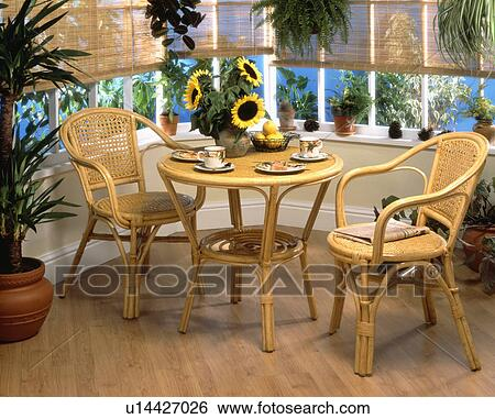 Nice Cane Chairs And Small Circular Table In Front Of The Window In Conservatory  Dining Room With Wooden Flooring