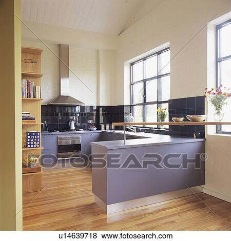 Pictures of mauve fitted cupboards in modern white kitchen for Mauve kitchen walls