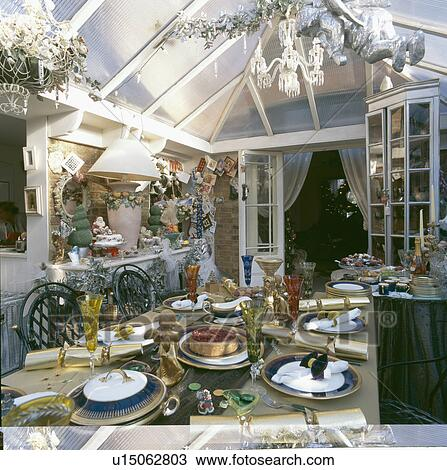 Stock Photo of Conservatory dining room with table decorated for ...