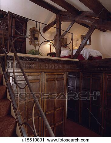 Stock photography of stairs leading to bed on mezzanine for How to build a mezzanine floor for bedroom