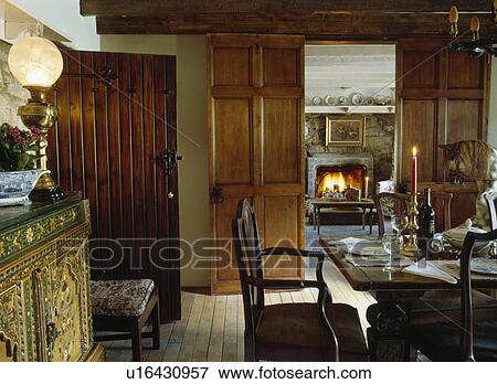Picture   Victorian Lamp On Sideboard In Dining Room With Double Wooden  Doors And View Of