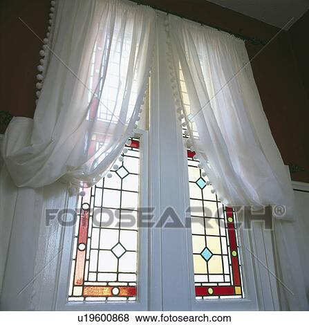 Pictures Of White Voile Curtains At Tall Stained Glass