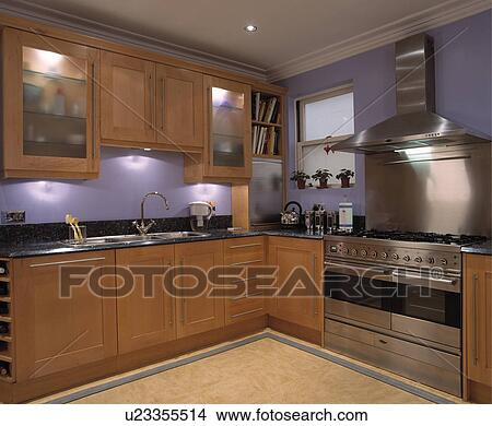 Stock photo of mauve painted contemporary kitchen with for Mauve kitchen walls