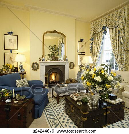 Stock Images of Traditional yellow cottage living room with ...