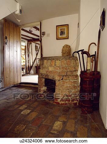 Stock images of brick flooring and fireplace in country for Country cottage floor tiles