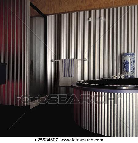 Circular Spa Tub With Corrugated Metal Surround In Modern Bathroom With  Corrugated Metal Walls And Shower Cabinet