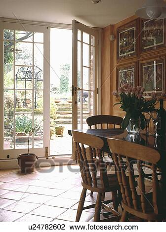 Pine Furniture In Dining Room Extension With Terracotta Tiled Floor And French Doors Open To Patio Gvarden