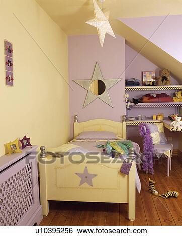 stock images of pastel yellow and mauve star themed child