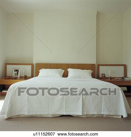 Immagine   semplice, bianco, copriletto, e, cuscini, su, luce ...