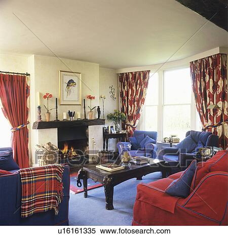 Stock image of red sofa and blue armchairs in traditional for Traditional armchairs for living room