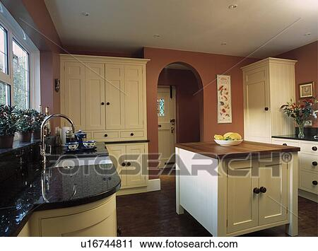 terra cotta kitchen stock photography of island unit in terracotta kitchen with cream