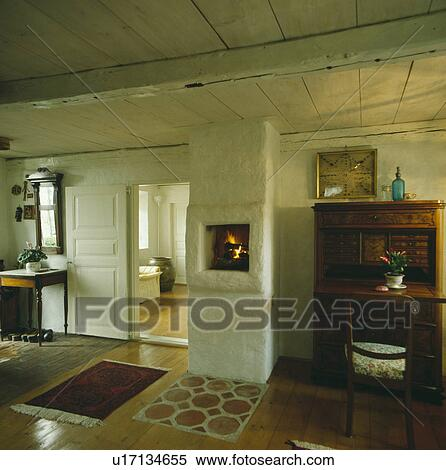 stock bild kaminofen in rustikal wand in wei. Black Bedroom Furniture Sets. Home Design Ideas