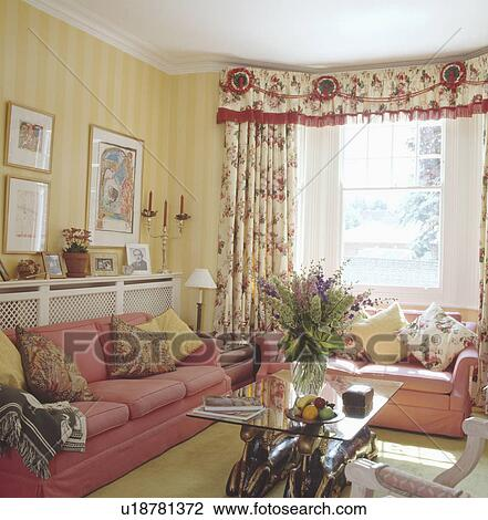 Stock Photo Of Pink Sofas And Yellow Striped Wallpaper In