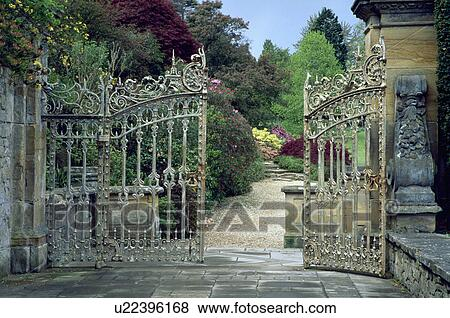 ornate wrought iron gate. ornate wrought iron gates to large country garden in summer gate
