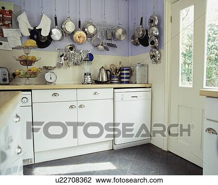 Stock photo of stainless steel pans on wall above for Mauve kitchen walls