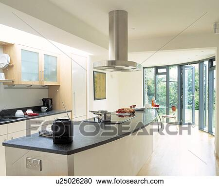 Modern Kitchen Extractor Fans stock photography of extractor fan above radio on island unit with