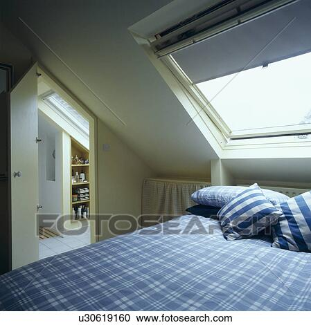 Stock Photography Of Blue Blind On Velux Window Above Bed