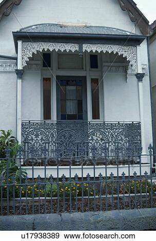 Ornate Wrought Iron Balcony And Awning On Victorian Townhouse