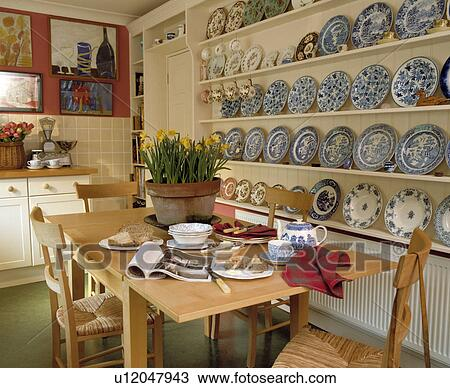 stock photo of blue white plates on white shelves in