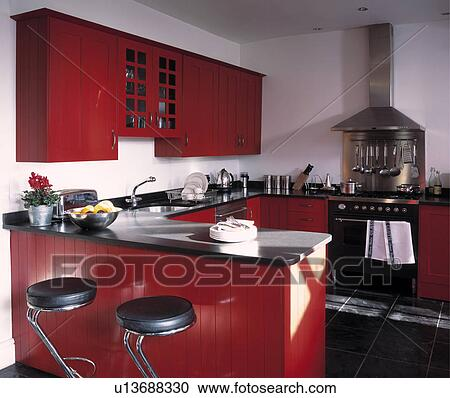 Stock photography of black leather and chrome stools at for Red fitted kitchen