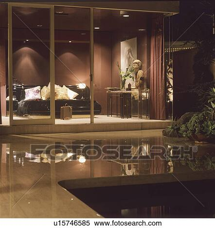 Stock Image - View from patio of modern living rom with glass doors. Fotosearch - & Stock Image of View from patio of modern living rom with glass ... Pezcame.Com