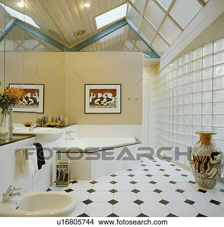 Black+white Chequerboard Floor Tiles In Modern Bathroom Extension With  Glass Brick Wall And Corner Bath