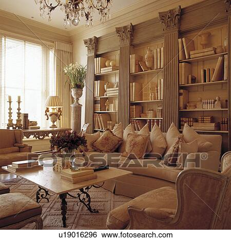 Cream Sofa In Traditional Living Room With Classical Pillars On Bookcase Part 58