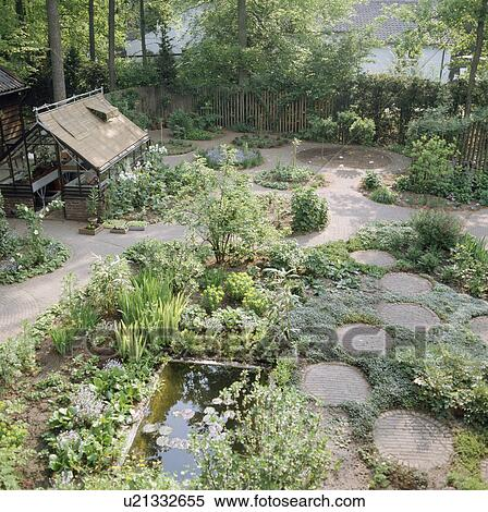 Stock Image   Paved Circles And Rectangular Pond In Enclosed Country Garden.  Fotosearch   Search